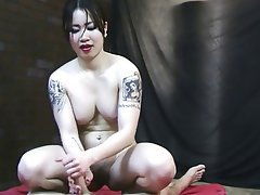 Asian mature lady gives handjob