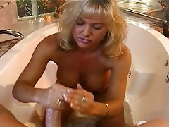 Mature handjob facial