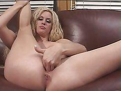 Blond mature masturbating